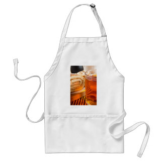 Brown sponge cake and cup of hot tea adult apron