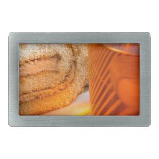 Brown sponge cake and cup of hot tea rectangular belt buckle