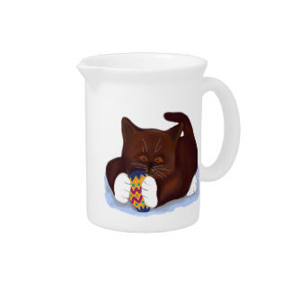Brown Tuxedo Kitten Finds an Easter Egg Beverage Pitcher