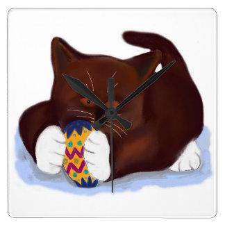 Brown Tuxedo Kitten Finds an Easter Egg Square Wallclocks