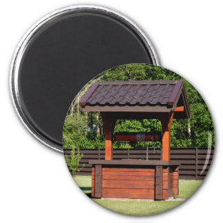 Brown wooden well | magnet