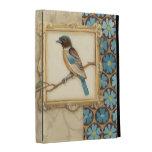 Brown y pájaro azul en una rama que mira para