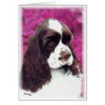 Brown y tarjeta blanca del perrito del cocker