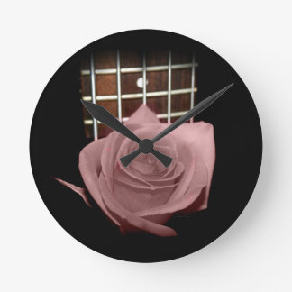 Brownish pink single rose against fretboard clock