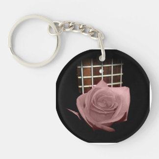 Brownish pink single rose against fretboard round acrylic keychain