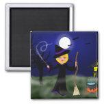 Bruja de Halloween con la caldera Imán