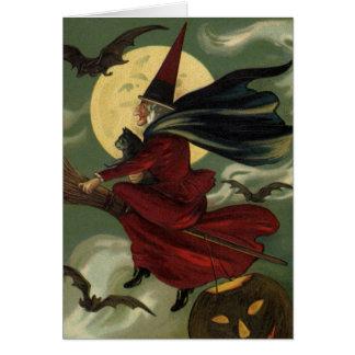 Bruja de Halloween del vintage que monta una escob Tarjetón