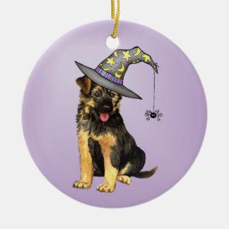 Bruja del pastor alemán adorno navideño redondo de cerámica