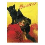 Bruja y gato de Halloween del vintage Postal