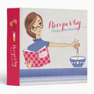 Brunette woman cracking eggs recipe cookbook binder