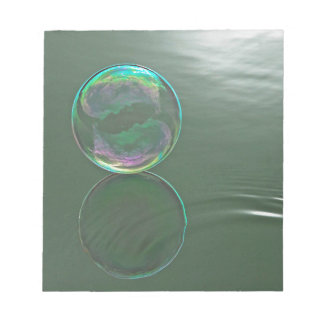 Bubble floating on water notepad