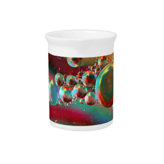 Bubbles and Raven Abstract Planets Beverage Pitcher