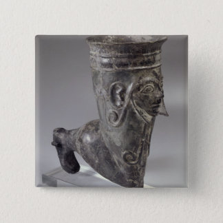 Bucchero vessel in the form of a leg with sculpted pinback button