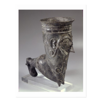 Bucchero vessel in the form of a leg with sculpted postcard