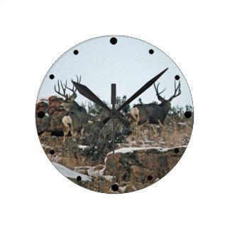 Buck deer first snow round clock