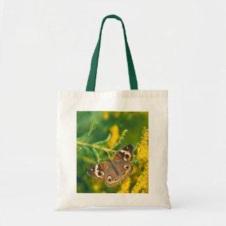 buckeye butterfly on missouri goldenrod tote bag