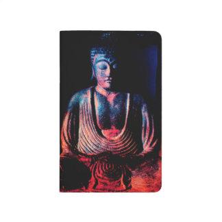 Buda asentó cuaderno grapado