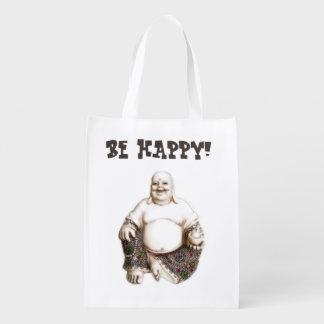 Buda de risa feliz alegre bolsas de la compra