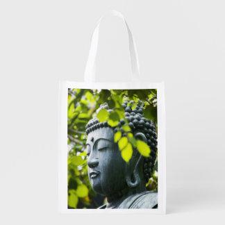 Buda en jardín del templo de Senso-ji Bolsas De La Compra