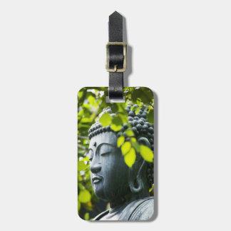 Buda en jardín del templo de Senso-ji Etiquetas Bolsas