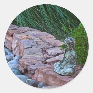 Buda meditating by the stream classic round sticker