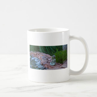 Buda meditating by the stream coffee mug