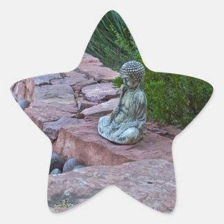 Buda meditating by the stream star sticker