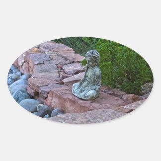 Buda meditating by the stream stickers