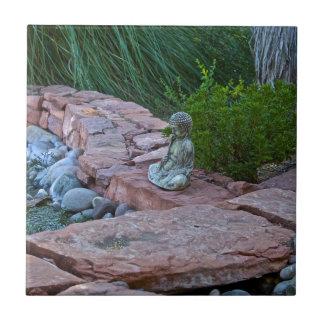 Buda meditating by the stream ceramic tile