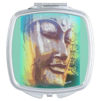 buddha face green makeup mirror
