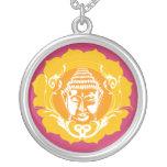 Buddha face in orange necklaces