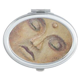 buddha face makeup mirror