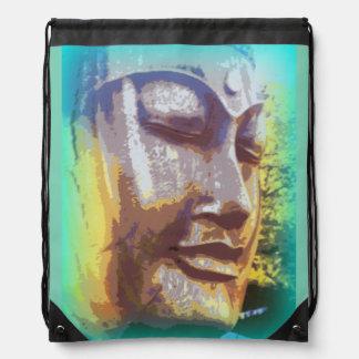 buddha face on green drawstring bag