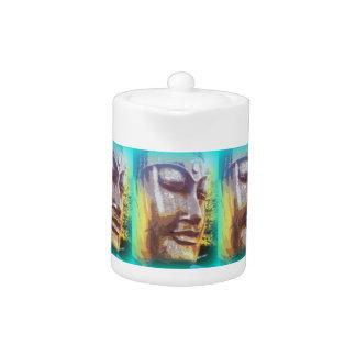 Buddha faces teapot