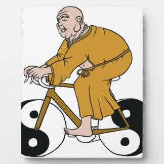 Buddha Riding A Bike With Yin Yang Wheels Plaque