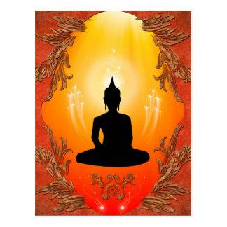 Buddha silhouette with glowing light postcard