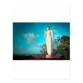 Buddha statue and crow overlooking ocean postcard