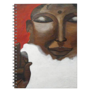 Buddha's face on clouds in the skies spiral notebook