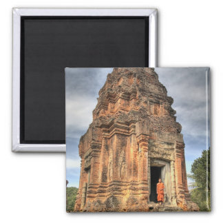 Buddhist monk standing in doorway of temple 2 inch square magnet