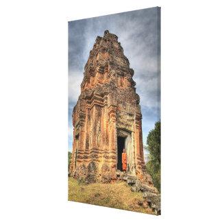 Buddhist monk standing in doorway of temple canvas print