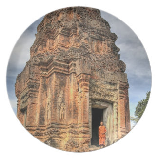 Buddhist monk standing in doorway of temple dinner plate