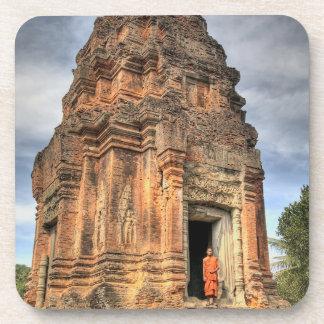 Buddhist monk standing in doorway of temple drink coaster