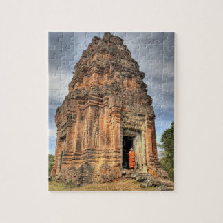 Buddhist monk standing in doorway of temple jigsaw puzzle