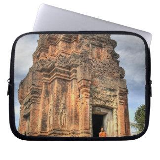 Buddhist monk standing in doorway of temple laptop sleeve