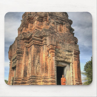 Buddhist monk standing in doorway of temple mouse pad