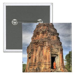 Buddhist monk standing in doorway of temple pinback button