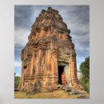 Buddhist monk standing in doorway of temple posters