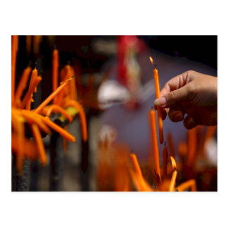 Buddhist Prayer Candle Lighting Ritual At Temple Postcard