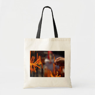 Buddhist Prayer Candle Lighting Ritual At Temple Tote Bag
