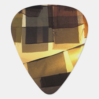 Buddhist prayer flags in the sunset, guitar pick